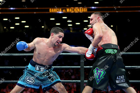 Danny Garcia, Paul Malignaggi Danny Garcia lands a left against Paul Malignaggi during their welterweight fight at the Barclays Center in Brooklyn, on . Garcia won via TKO in Round 9