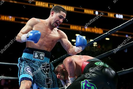 Danny Garcia, Paul Malignaggi Danny Garcia, left, in action against Paul Malignaggi during their welterweight fight at the Barclays Center in Brooklyn, on . Garcia won via TKO in Round 9