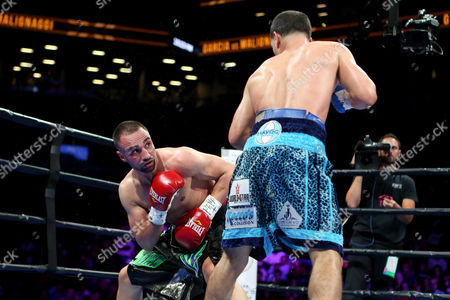 Danny Garcia, Paul Malignaggi Paul Malignaggi slips a punch against Danny Garcia during their welterweight fight at the Barclays Center in Brooklyn, on . Garcia won via TKO in Round 9
