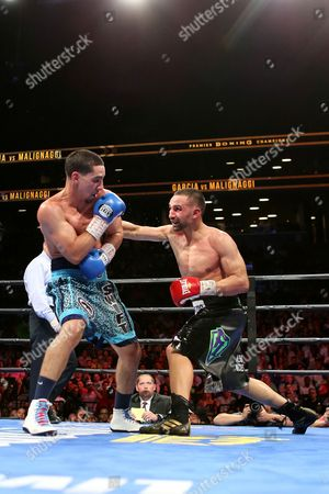Danny Garcia, Paul Malignaggi Danny Garcia takes a right from Paul Malignaggi during their welterweight fight at the Barclays Center in Brooklyn, on . Garcia won via TKO in Round 9