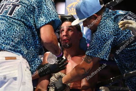 Danny Garcia Danny Garcia is worked on in his corner between rounds against Paul Malignaggi during their welterweight fight at the Barclays Center in Brooklyn, on . Garcia won via TKO in Round 9