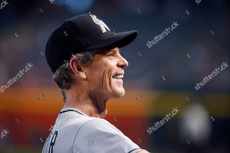 Brett Butler Miami Marlins first base coach Brett Butler smiles as he recognizes a fan in the stands prior to a baseball game against the Arizona Diamondbacks, in Phoenix
