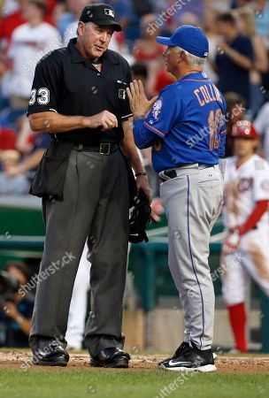 Mike Winters, Terry Collins Home plate umpire Mike Winters (33) talks with New York Mets manager Terry Collins (10) during a baseball game against the Washington Nationals at Nationals Park, in Washington