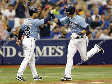 Richie Shaffer, Charlie Montoyo Tampa Bay Rays' Richie Shaffer, right, high fives third base coach Charlie Montoyo, left, after hitting a home run off New York Mets starting pitcher Bartolo Colon during the seventh inning of an interleague baseball game, in St. Petersburg, Fla. The Rays on the game 4-3