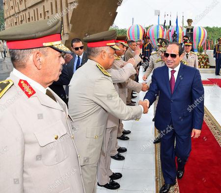 Egyptian President Abdel Fattah al-Sisi visits the graves of the unknown soldier, Egypt's former President Gamal Abdel Nasser, and Egypt's former President Anwar Sadat