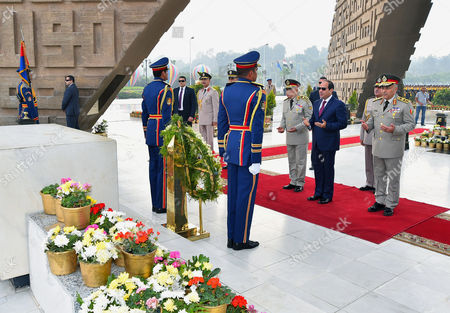 Stock Picture of Egyptian President Abdel Fattah al-Sisi visits the graves of the unknown soldier, Egypt's former President Gamal Abdel Nasser, and Egypt's former President Anwar Sadat