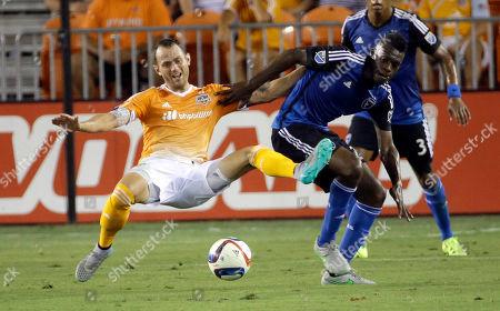 Brad Davis, Fatai Alashe Houston Dynamo's Brad Davis, left, falls while battling San Jose Earthquakes' Fatai Alashe, right, for the ball during the first half of an MLS soccer match, in Houston