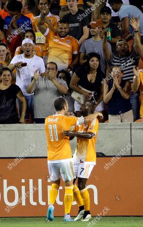 DaMarcus Beasley, Brad Davis Houston Dynamo's DaMarcus Beasley (7) is congratulated by Brad Davis (11) after scoring a goal against the San Jose Earthquakes during the second half of an MLS soccer match, in Houston. The Dynamo won 2-1