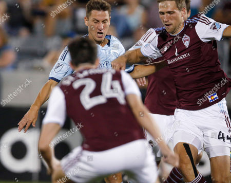 Krisztian Nemeth, Sean St. Ledger, Avel Sjoberg Sporting Kansas City forward Krisztian Nemeth, back left, takes a shot for a goal as Colorado Rapids' Sean St. Ledger, front, and Axel Sjoberg defend during the second half of an MLS soccer match in Commerce City, Colo., . The Rapids won 2-1