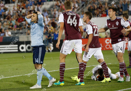 Dom Dwyer, Axel Sjoberg, Lucas Pittinari, Sean St. Ledger, Clint Irwin Sporting Kansas City forward Dom Dwyer, left, reacts after his shot hit the goalpost and was stopped as Colorado Rapids defender Axel Sjoberg, midfielder Lucas Pittinari and defender Sean St. Ledger look on while goalkeeper Clint Irwin, back, covers the ball in the second half of an MLS soccer match in Commerce City, Colo