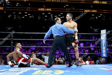 Daniel Jacobs, Sergio Mora Daniel Jacobs is knocked down by Sergio Mora in round 1 during their WBA Middleweight title fight at the Barclays Center in Brooklyn, on