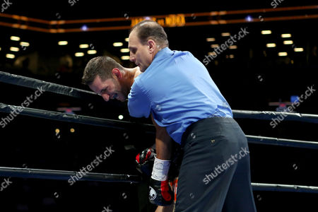 Sergio Mora Sergio Mora is held by the referee after the fight ended round 2 when Mora could not continue after being knocked down by Daniel Jacobs during their WBA Middleweight title fight at the Barclays Center in Brooklyn, on . Jacobs won via TKO in round 2 when Mora could not continue due to an ankle injury