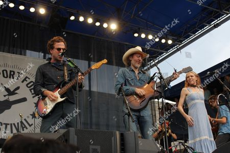 """Taylor Goldsmith, of Dawes, left, David Rawlings, center, and Gillian Welch, right, play a cover of Bob Dylan's """"Maggie's Farm"""" at the Newport Folk Festival, during a celebration of the 50th anniversary of when Dylan went electric in Newport, R.I. Goldsmith is playing the Fender Stratocaster guitar that Dylan used in his 1965 performance"""