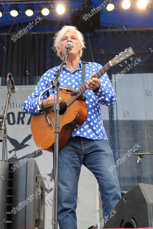 Robyn Hitchcock makes a surprise appearance at the Newport Folk Festival, during a celebration of the 50th anniversary of when Bob Dylan went electric in Newport, R.I