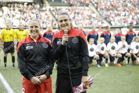 Nadine Angerer, Rachel Van Hollebeke Portland Thorns goalkeeper Nadine Angerer, right, speaks to the fans with teammate Rachel Van Hollebeke at left before an NWSL soccer match against the Washington Spirit in Portland, Ore., . Both Angerer and Hollebeke have announced they are retiring from soccer