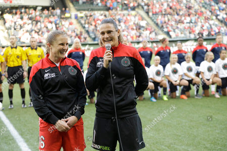 Stock Picture of Nadine Angerer, Rachel Van Hollebeke Portland Thorns goalkeeper Nadine Angerer, right, speaks to the fans with teammate Rachel Van Hollebeke at left before an NWSL soccer match against the Washington Spirit in Portland, Ore., . Both Angerer and Hollebeke have announced they are retiring from soccer