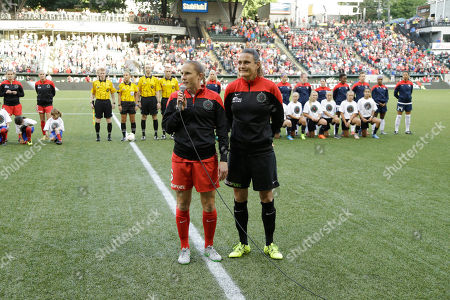 Stock Image of Nadine Angerer, Rachel Van Hollebeke Portland Thorns goalkeeper Nadine Angerer, right, stands with teammate Rachel Van Hollebeke before an NWSL soccer match against the Washington Spirit in Portland, Ore., . Both Angerer and Hollebeke have announced they are retiring from soccer