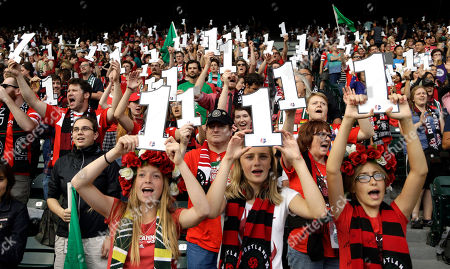 Portland Thorns fans hold up signs in honor of Thorns goalkeeper Nadine Angerer during the first half of an NWSL soccer match against the Washington Spirit, in Portland, Ore. Angerer recently announced her retirement from soccer