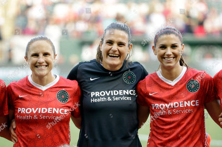 Nadine Angerer, Rachel Van Hollebeke, Alex Morgan Portland Thorns goalkeeper Nadine Angerer, middle, stands for a team photo with teammates Rachel Van Hollebeke, left, and Alex Morgan before an NWSL soccer match against the Washington Spirit in Portland, Ore., . Both Angerer and Hollebeke have announced they are retiring from soccer