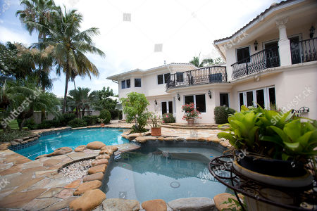 The back yard and pool area of the five-bedroom Florida mansion belonging to 1970's heartthrob David Cassidy in Fort Lauderdale, Fla. The home has sold for just over $2 million. Fisher Auction Co. spokesman Ryan Julison said a bankruptcy court approved the sale Friday, Sept. 25. The sale of the 7,000-square-foot waterfront home should close within 30 days. The 65-year-old Cassidy filed a Chapter 11 bankruptcy case earlier this year