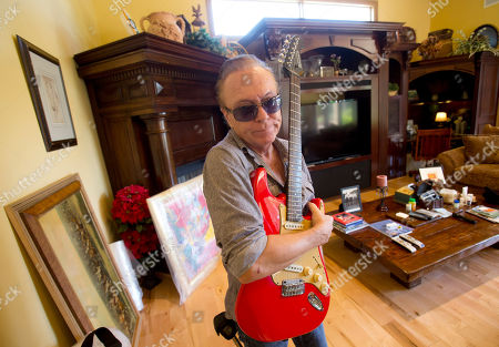 David Cassidy 1970's heartthrob David Cassidy holds one of his favorite guitars as he gives a tour of his five-bedroom Florida mansion in Fort Lauderdale, Fla. Cassidy, 65, is auctioning the waterfront home and all its furnishings Sept. 9 as part of bankruptcy and divorce proceedings. The pianos and guitars displayed throughout his home won't be included in the auction, as he's working on a Christmas album and an album of songs he learned from his father, actor and singer Jack Cassidy