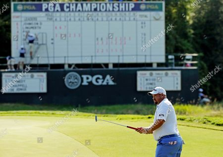 Brendon de Jonge, of Zimbabwe, putts on the 18th hole during the second round of the PGA Championship golf tournament, at Whistling Straits in Haven, Wis