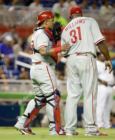 Carlos Ruiz, Jerome Williams Philadelphia Phillies catcher Carlos Ruiz, left, talks with starting pitcher Jerome Williams (31) in the first inning of a baseball game against the Miami Marlins, in Miami