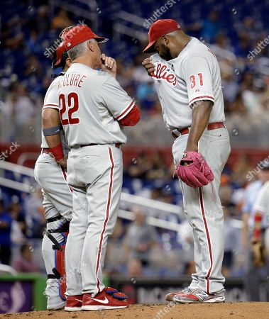 Jerome Williams, Bob McClure Philadelphia Phillies starting pitcher Jerome Williams (31) wipes his face as he talks with pitching coach Bob McClure (22) during the first inning of a baseball game against the Miami Marlins, in Miami