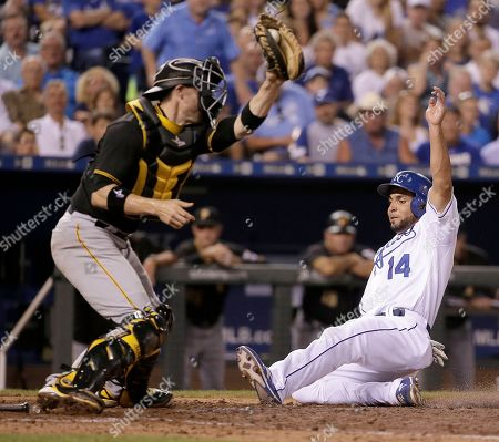 Omar Infante Kansas City Royals' Omar Infante (14) beats the tag at home by Pittsburgh Pirates catcher Chris Stewart to score on a bunt single by Jarrod Dyson during the seventh inning of a baseball game, in Kansas City, Mo