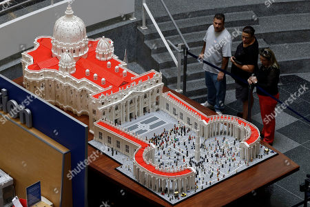 Stock Photo of Visitors view a Lego representation of the St. Peter's basilica and square, at The Franklin Institute in Philadelphia. The Rev. Bob Simon spent about 10 months building it with approximately half-a-million Legos