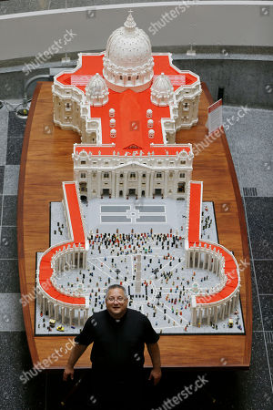 Stock Picture of The Rev. Bob Simon poses for a photograph with his Lego representation of the St. Peter's basilica and square, at The Franklin Institute in Philadelphia. Simon spent about 10 months building it with approximately half-a-million Legos
