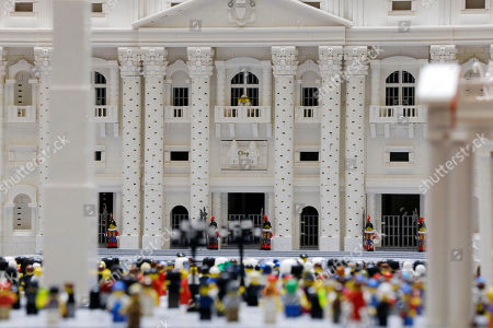 Shown a Lego pope figure on a balcony overlooking the crowd in the piazza in a Lego representation of the St. Peter's basilica and square, at The Franklin Institute in Philadelphia. The Rev. Bob Simon spent about 10 months building it with approximately half-a-million Legos