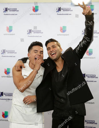 Reykon, Christian Daniel Musicians Reykon, left, and Christian Daniel, right, pose for a photo at the Premios Juventud 2015, in Coral Gables, Fla