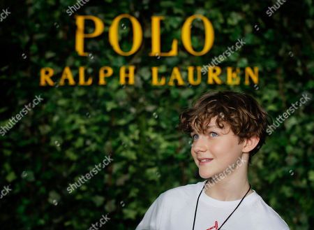 """Levi Miller, star of the upcoming film """"Pan,"""" answers questions during in interview after walking the runway in a Ralph Lauren Fall fashion show for children, in New York. Polo hosted the show to promote children's literacy but also to promote the October film, """"Pan,"""" which is Peter Pan's origin story"""