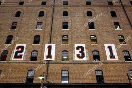 Numbers are emblazoned on the B&O Warehouse to mark the anniversary of former Baltimore Oriole Cal Ripken, Jr.'s streak of 2,131 straight games during a baseball game between the Orioles and the Tampa Bay Rays, in Baltimore