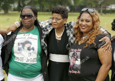 Geneva Reed-Veal, Calandrian Kemp, Jackie Johnson Geneva Reed-Veal, mother of Sandra Bland, center, stands with Jackie Johnson, left, from Valdosta, Ga., mother of Kendrick Johnson, and Calandrian Kemp, from Houston, Texas, mother of George Kemp Jr., as they attend a gravesite ceremony at the Burr Oak Cemetery marking the 60th anniversary of the murder of Emmett Till in Mississippi, in Alsip, Ill