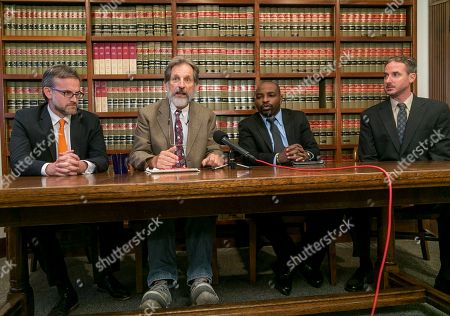 """Reuven Cohen, Dan Stormer, Emmanuel N'Shalai, Joshua Piovia-Scott Attorneys, from left, Reuven Cohen, Dan Stormer, Emmanuel N'Shalai and Joshua Piovia-Scott representing the family of late Charly Keunang take questions at a news conference in Pasadena, Calif.,n . The family of Keunang, a native of Cameroon, filed the lawsuit in Los Angeles County Superior Court on Wednesday, saying it's """"a classic case of abuse of power and deadly force."""" It also names police Chief Charlie Beck and the three officers who fired the six bullets that hit Keunang, including two to the chest"""