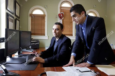 Stock Photo of Gilbert Cerda, Aaron Munoz Certified financial planners Aaron Munoz, left, and Gilbert Cerda, pose for a photo at their offices in Downey, Calif. Their company, Cerda Munoz Advisors, offers financial advice with a focus on the Hispanic population