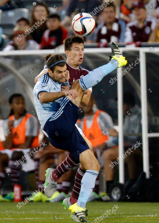 Sean St. Ledger, Graham Zusi Sporting KC midfielder Graham Zusi, front, collides with Colorado Rapids defender Sean St. Ledger in the first half of an MLS soccer match, in Commerce City, Colo