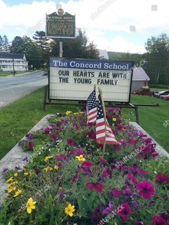 A sign expressing condolences to the Young family is displayed outside The Concord School, in Concord, Vt. Robert Young, 41, and his 8-year-old daughter, Annabelle died Monday, Aug. 3, when a circus collapsed during a storm in Lancaster, N.H