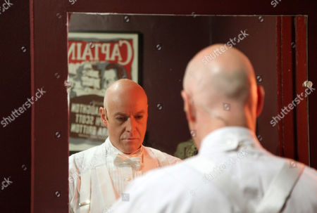 """Stock Picture of Australian singer and actor Anthony Warlow gets ready for his role as theatrical producer Charles Frohman in the musical """"Finding Neverland,"""" in New York. Warlow is playing dual roles as Frohman and a fearsome Captain Hook"""