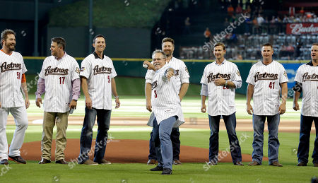 Phil Garner, Chad Qualls, Lance Berkman, Brad Lidge, Morgan Ensberg, Adam Everett, Brandon Backe, Roy Oswalt Former Houston Astros manager Phil Garner (3) throws out a ceremonial first pitch as members of he 2005 World Series team watch before the Astros' baseball game, in Houston. From left are Chad Qualls (50), Lance Berkman (17), Brad Lidge (54), Morgan Ensberg, Adam Everett, Brandon Backe (41) and Roy Oswalt