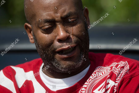 Simon Bell Mourner Simon Bell cries outside funeral services for Samuel Dubose at the Church of the Living God in the Avondale neighborhood of Cincinnati, . Dubose was fatally shot by a University of Cincinnati police officer who stopped him for a missing license plate