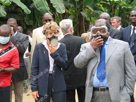 Stock Photo of French Minister Brigitte Girardin and Ivorian Prime Minister Charles Konan Banny visit the area where toxic waste was dumped at Akuedo village in Abidjan.