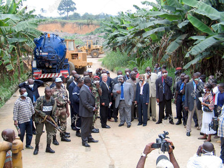 Ivorian Prime Minister Charles Konan Banny and a French delegation visit the area where toxic waste was dumped at Akuedo village in Abidjan.