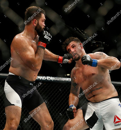 Andrei Arlovski punches Frank Mir during their heavyweight mixed martial arts bout at UFC 191, in Las Vegas