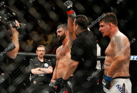 Andrei Arlovski is named the winner over Frank Mir in their heavyweight mixed martial arts bout at UFC 191, in Las Vegas