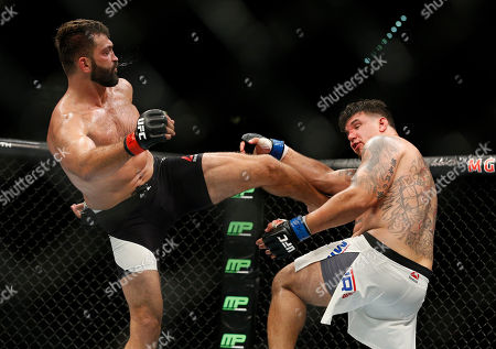 Andrei Arlovski kicks Frank Mir during their heavyweight mixed martial arts bout at UFC 191, in Las Vegas