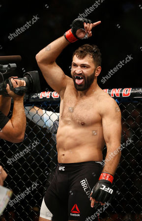 Andrei Arlovski gestures before fighting Frank Mir in a heavyweight mixed martial arts bout at UFC 191, in Las Vegas