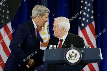 Former GOP Senator Richard Lugar, right, and Secretary of State John Kerry shake hands before Kerry's speech in support of the Iran nuclear deal at the National Constitution Center, in Philadelphia